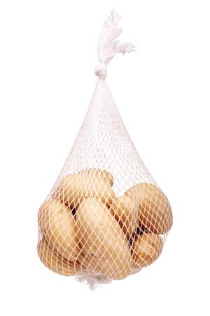 bunch fresh potatoes in a white mesh bag photo