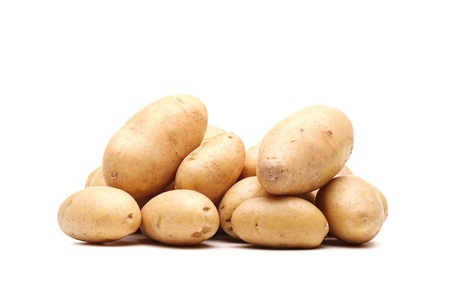 viands: bunch of fresh potatoes against white