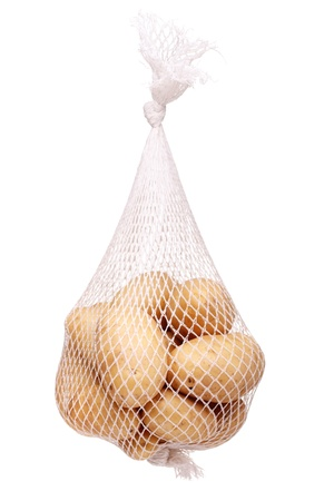 bunch fresh potatoes in a white mesh bag Stock Photo