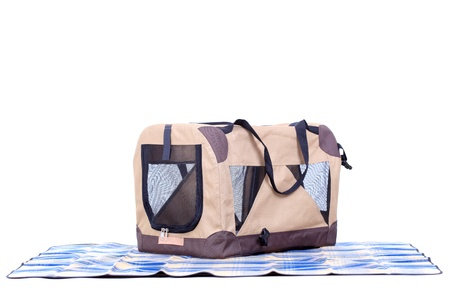 pet carrying bag and a blanket against white background Stock Photo - 12431207