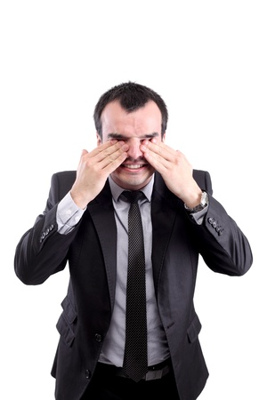 confused businessman rubbing his eyes, isolated on white photo