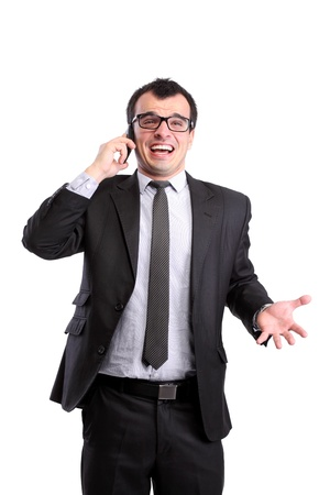 surprised businessman on the phone, isolated on white photo