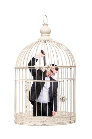 suicidal business man locked in a cage photo