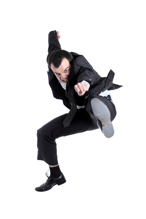 young business man jumping, isolated on white background photo