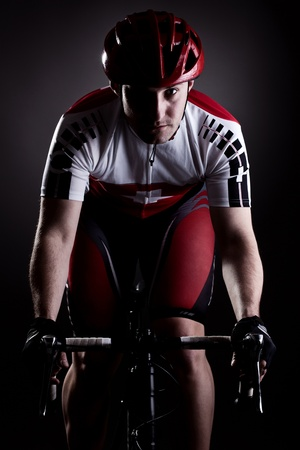 racing bike: fully equipped cyclist riding a bicycle Stock Photo