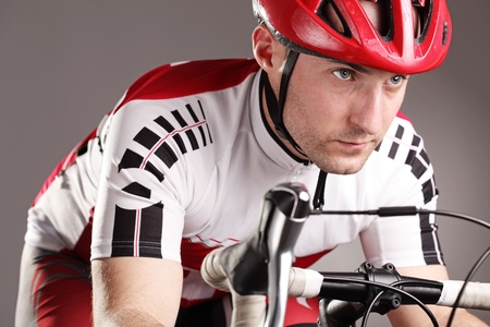 fully equipped cyclist riding a bicycle Stock Photo