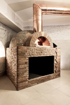 wood fired oven in a reataurant interior photo