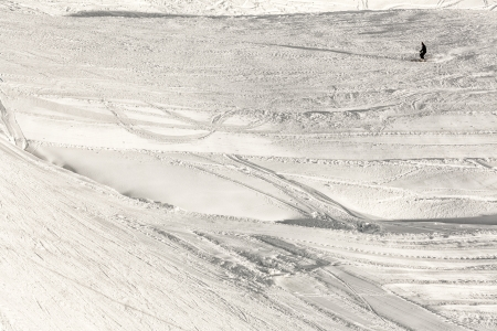 abstract ski slopes with a skier silhouette photo