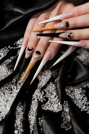 extremely long nails with nail-art and crystal jewellery,