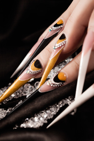 nailart: extremely long nails with nail-art and crystal jewellery,