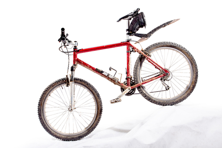 red hardtail mountain bike in a very dirty condition Stock Photo