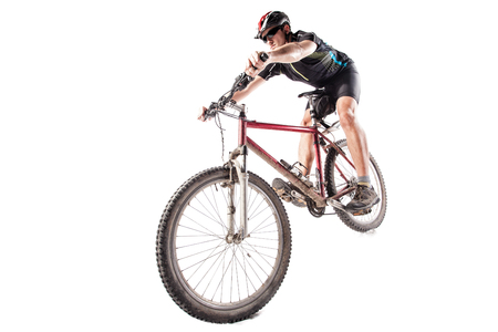 Male bicyclist riding a very dirty mountain bike downhill style Stock Photo