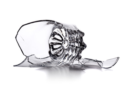 broken empty glass isolated on white background