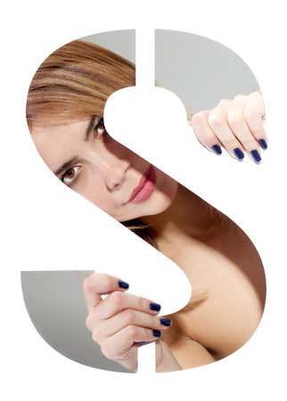 girl hiding behind and holding the letter S Stock Photo
