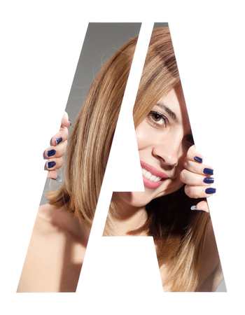 girl hiding behind and holding the letter A