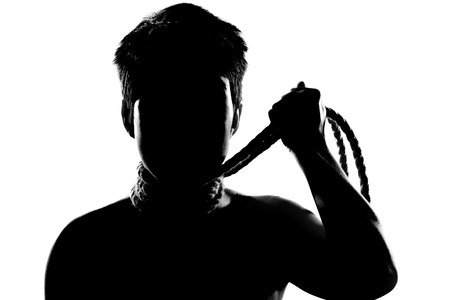 silhouette portrait of a girl with short hair, having rope around her neck Stock Photo