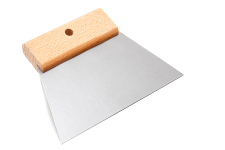 flexible putty scraper with wooden handle isolated on white