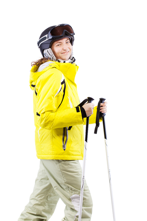 female skier in yellow jacket with poles isolated on white background