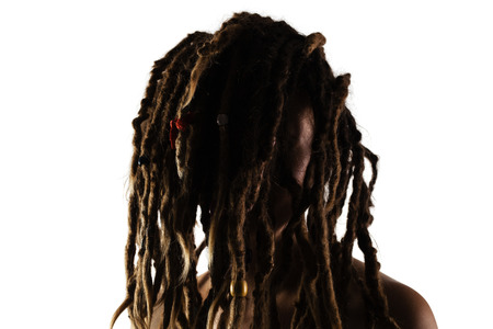 5c6a6690a67 portrait of a caucasian girl with dreadlocks in front of her face