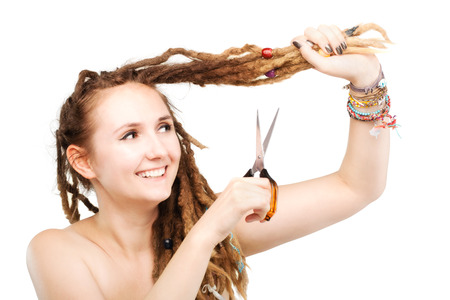 portrait of a caucasian girl with scissors about to cut her dreadlocks  Stock Photo