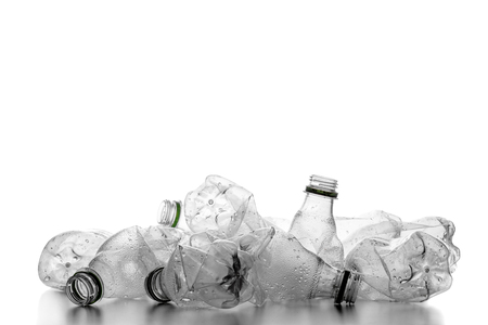 group of smashed empty plastic bottles, isolated on white background
