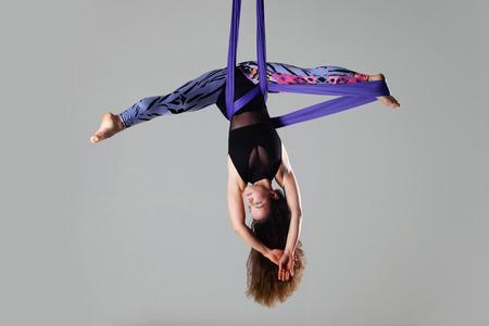 female posing aerial anti-gravity yoga on a hammock Stock Photo