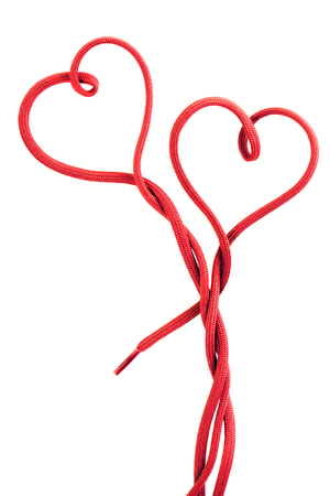 red shoe lace in a shape of two hearts Banco de Imagens - 118782953