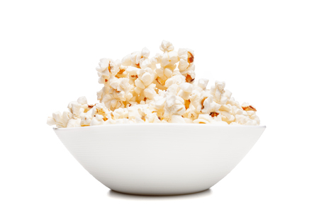 white bowl with popcorn against white background