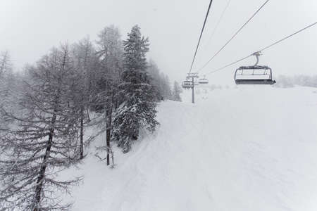 chair lift in ski center les arcs, paradiski on the french alps on a winter snowy day