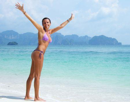 thong bikini: girl happy at the beach