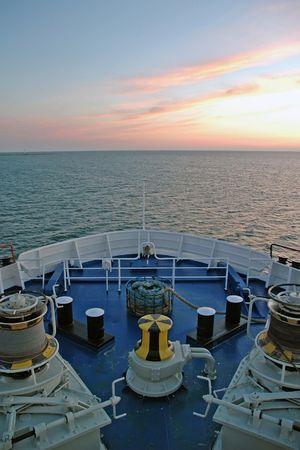 sunset and ship and sea Standard-Bild