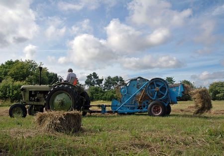 vintage tractor works on field