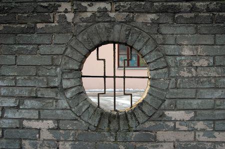 lattice window: lattice window in the brickwall   Stock Photo