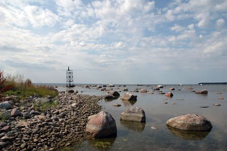 beacon at seaside with amount of rocks Stock Photo - 5369464