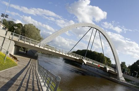 The supporting modern arch bridge across the river