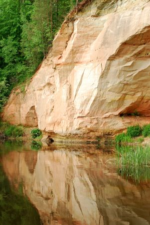 sandstone wild riverbank with cave
