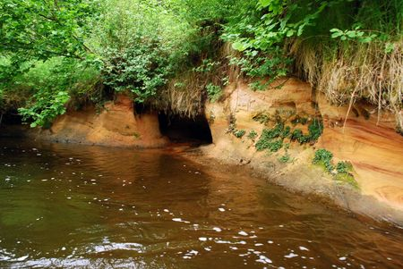 wild riverbank with cave in sandstone Stock Photo - 6146358