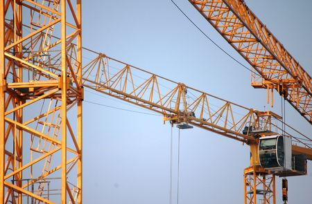 yellow construction crane on blue sky photo