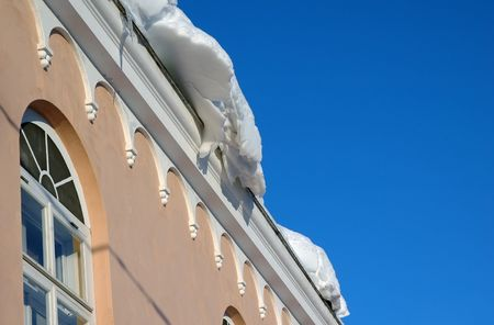 lot of snow on the roof at winter photo