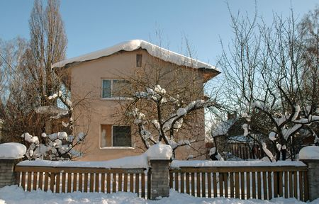 Front yard of a house covered with snow Stock Photo - 6392324