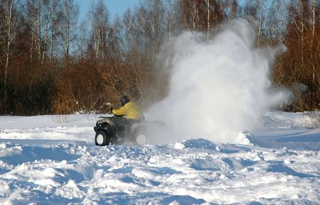 all terrain vehicle in motion at winter Stock Photo - 6392323