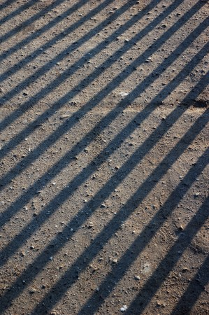 Abstract color pattern of shadow stripe lines from blinds photo