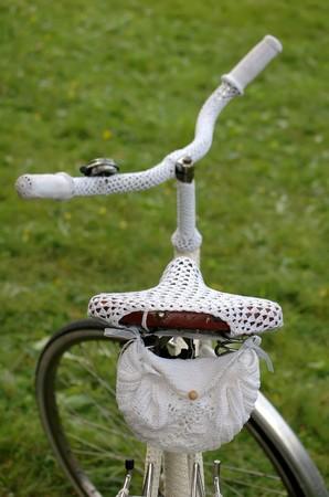 retro bike with white crochet clothing  photo