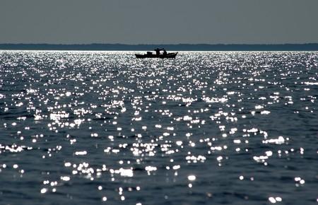 fishermen on the sea at eavning Stock Photo