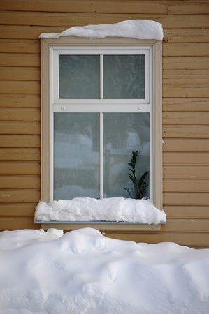 window covered by snow at winter photo