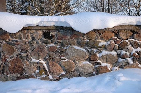snow on old stone wall Stock Photo - 8532228