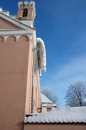 lot of snow on the mansion roof at winter photo