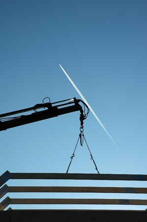 poling: Silhouette of the construction and crane with jet plane in sky Stock Photo
