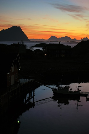port with houses and ship silhouette during sunrise in Lofoten, Norway Stock Photo - 11818748