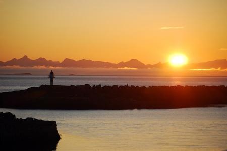 Lighthouse at sunrise in Lofoten, Norway Standard-Bild